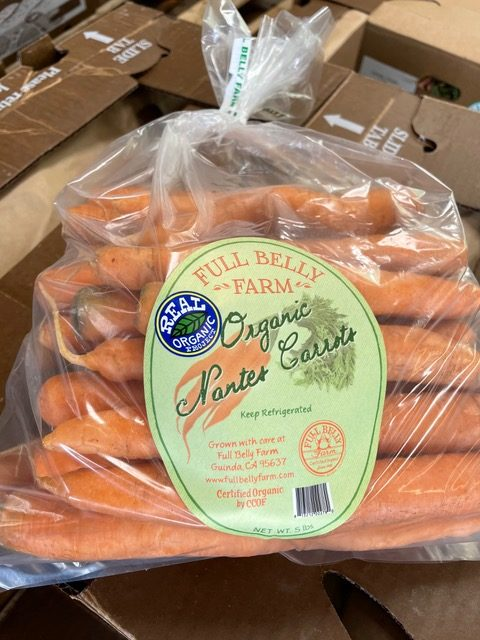 "A clear bag filled with orange carrots and a label reading ""Full Belly Farm Nantes Carrots. Product of the U.S.A. Real Organic Project"""