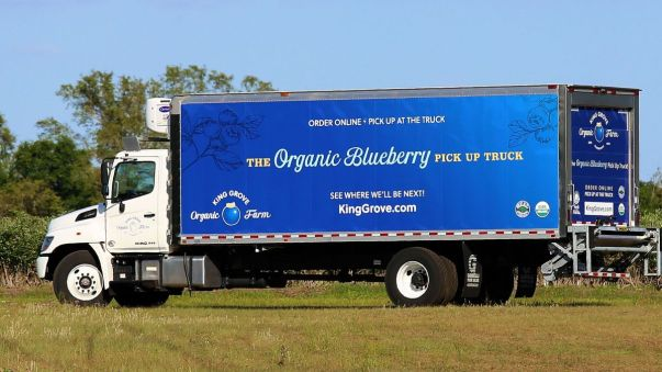 A semi truck with a 30ft blue box