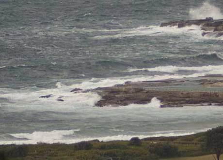 SE winds ripping the little swell to bits at around 0800.