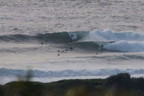 DY point surfers in big waves