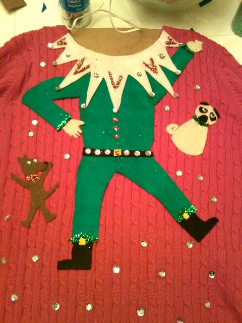 Elf Sweater: If you are attending an ugly Christmas sweater party this year, we have got you covered! Here are 25 Ugly Christmas Sweater Ideas for you to use as inspiration.