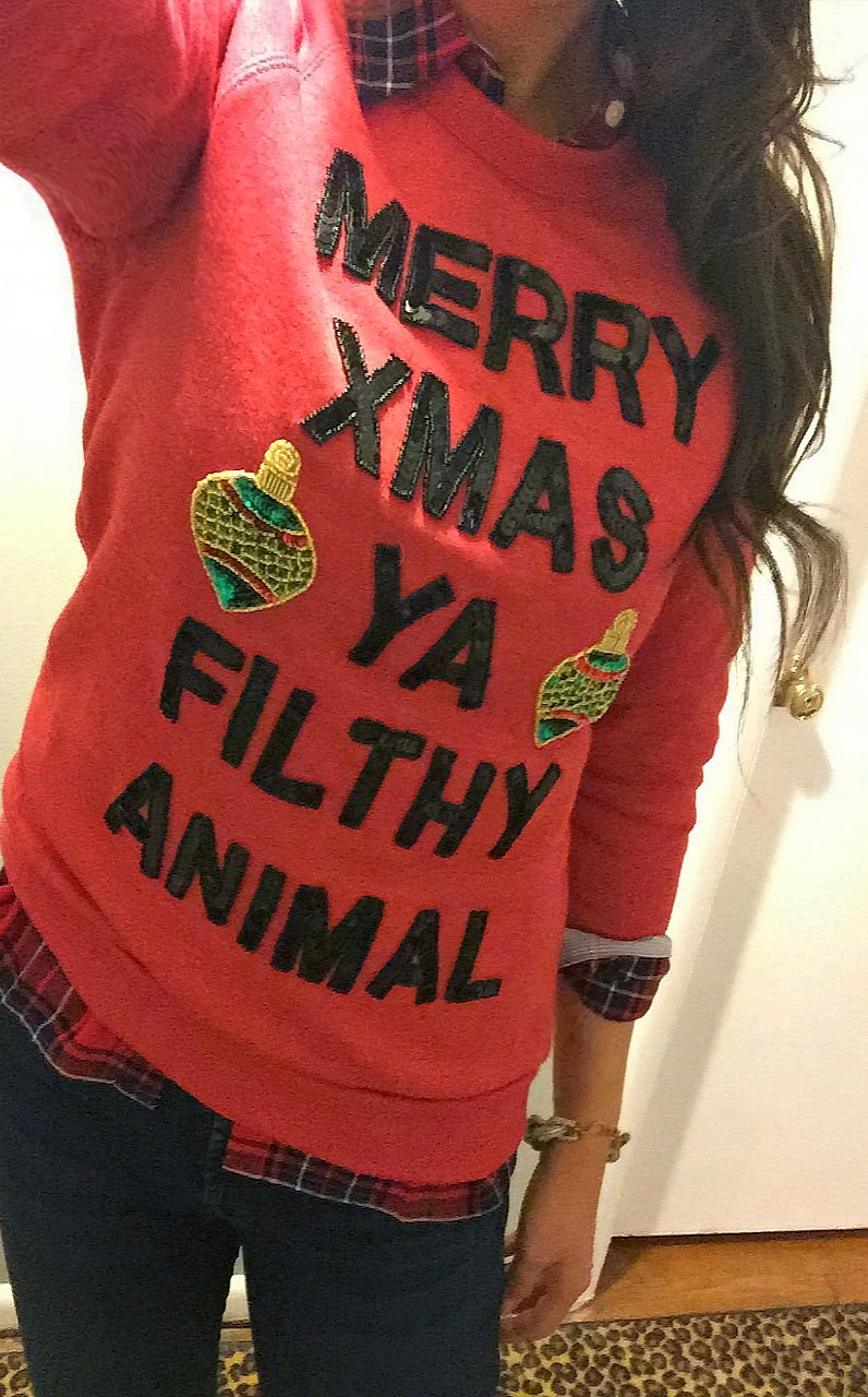 Ya Filthy Animal Sweater: If you are attending an ugly Christmas sweater party this year, we have got you covered! Here are 25 Ugly Christmas Sweater Ideas for you to use as inspiration.