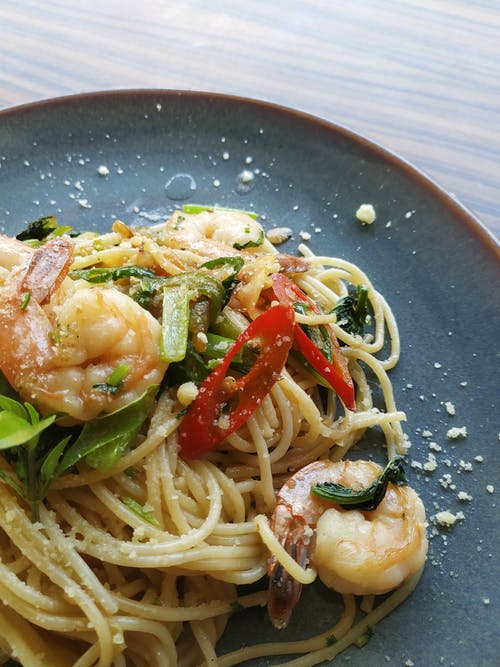 shrimp pasta served on gray plate