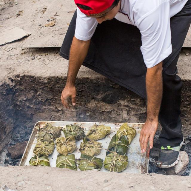 The 'Pib' - a traditional Mayan technique of using the heat of the earth to cook. Photo via museodelagastronomiayucateca.com