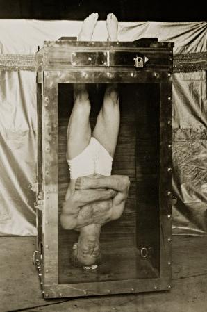 Harry Houdini in water chamber