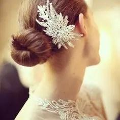 2015 Wedding Trends -Simple bun with jewelled clip from Rebecca Loves Weddings www.rebeccaanderton.co.uk