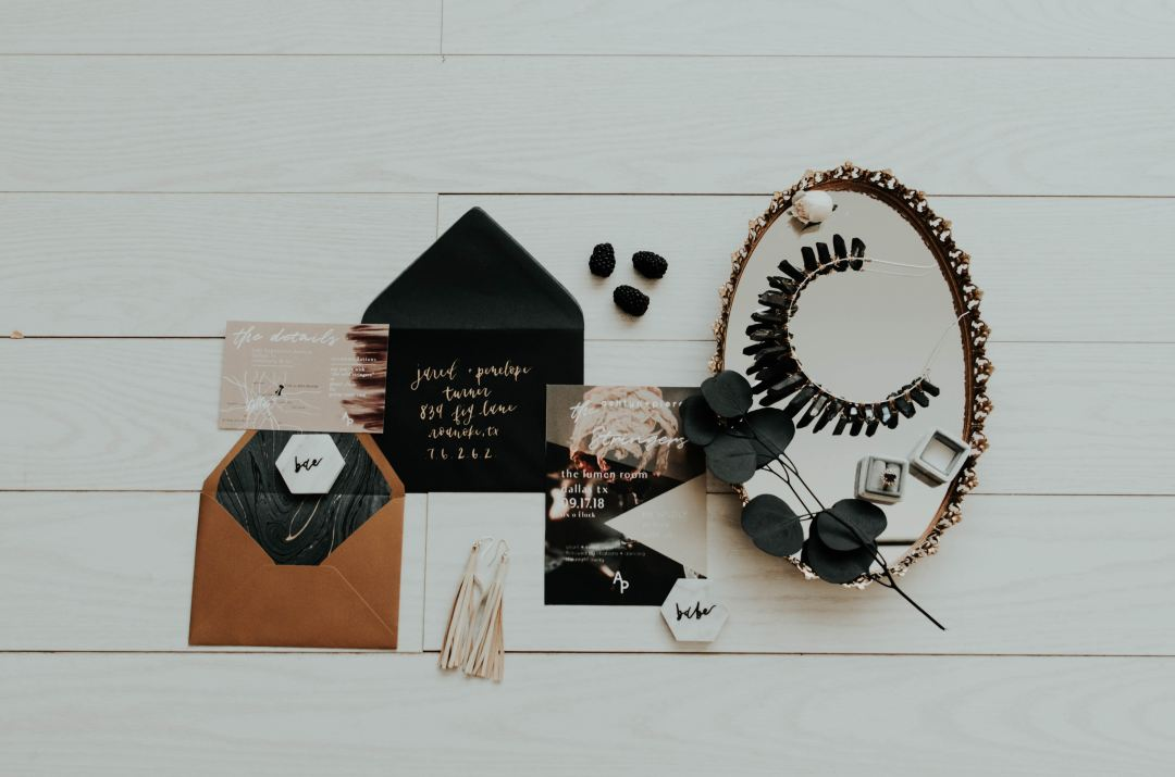 set of brand assets including invitation, envelope. Mirror with jewelry.