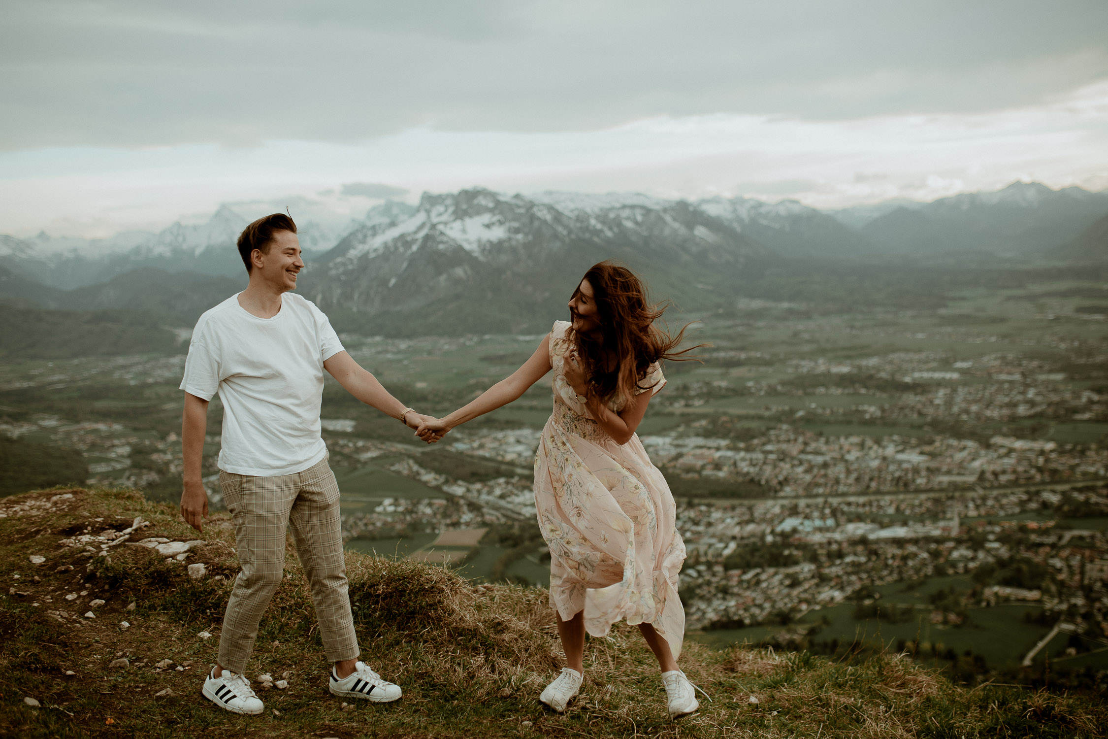 couple in the mountains holding hands
