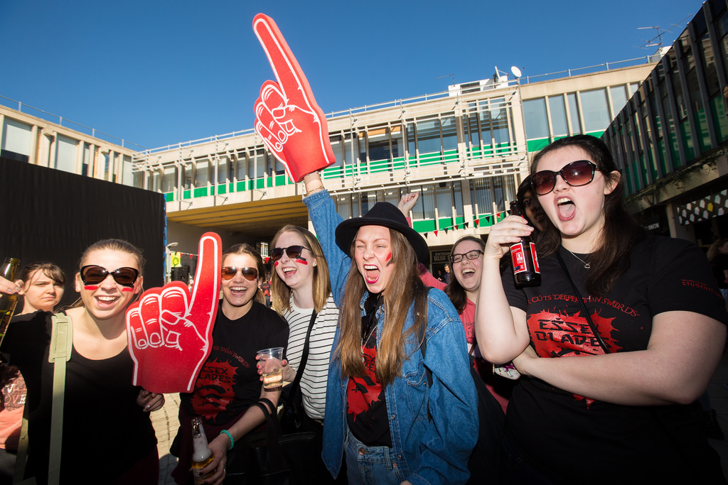 Picture of a group of students at Essex university wearing derby day t shirts and cheering