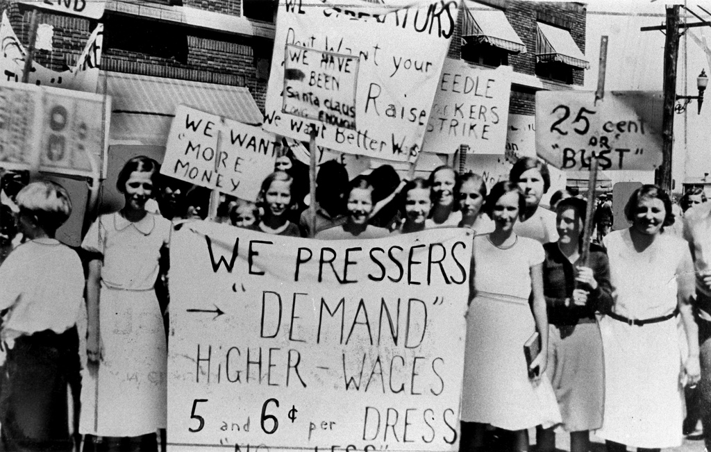 Women protesting higher wages for dress making.