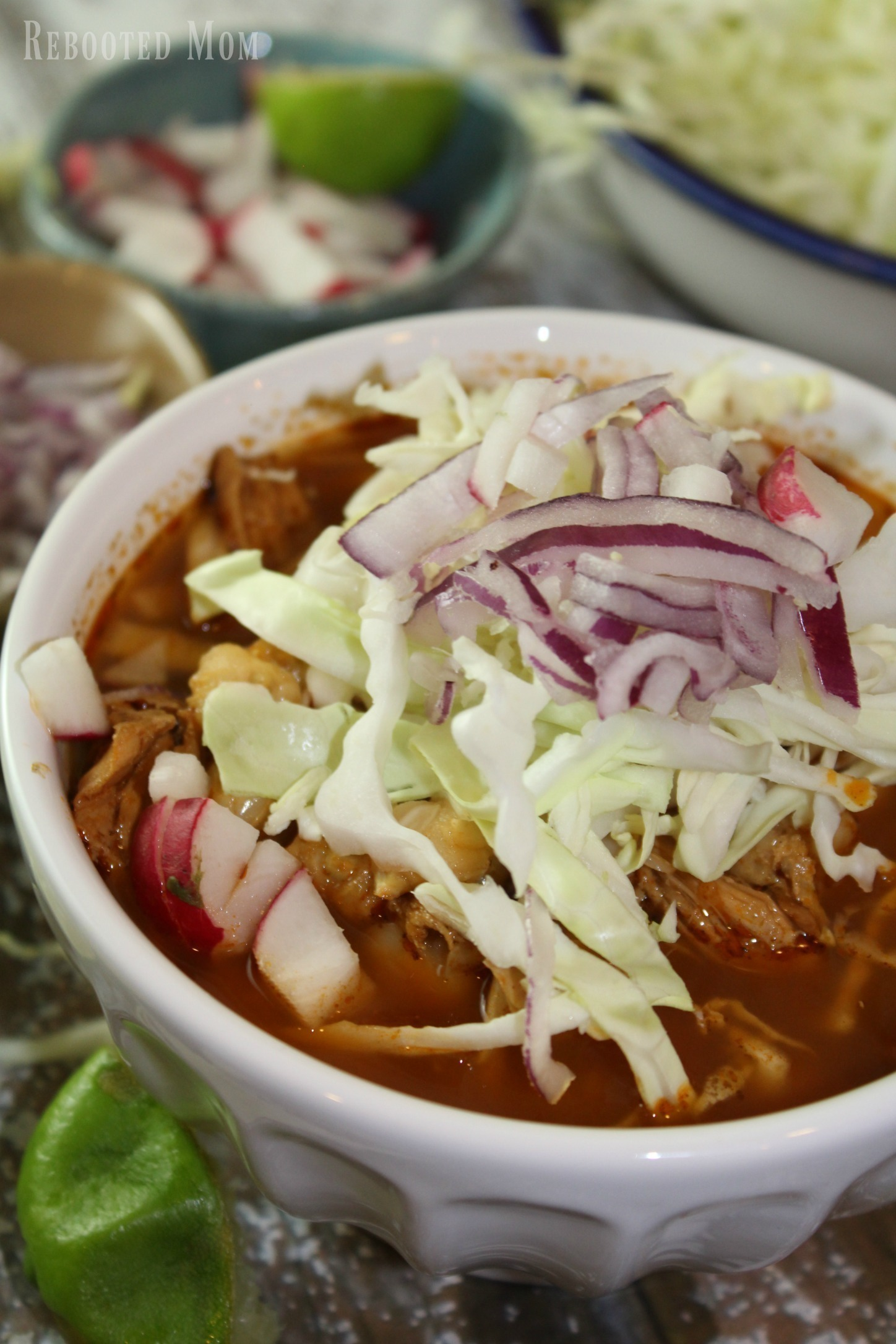 This Mexican stew features chiles and hominy, in a rich flavorsome broth. Dress up the stew with radishes, onions and sliced cabbage. It's traditional to serve the chicken in whole pieces but you can also pull it off the bone for even greater flavor.