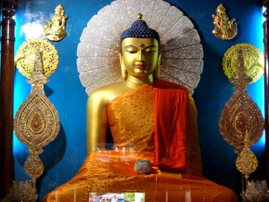 "The Buddha statue in ""touching the earth"" pose at Mahabodhi temple Photo Credit: lionel.viroulaud via Compfight cc"