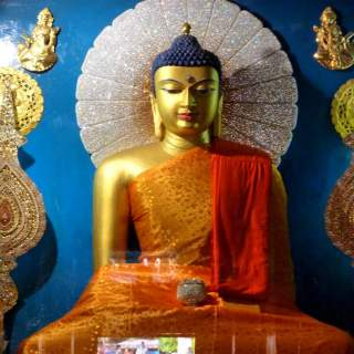 """The Buddha statue in """"touching the earth"""" pose at Mahabodhi temple Photo Credit: lionel.viroulaud via Compfight cc"""