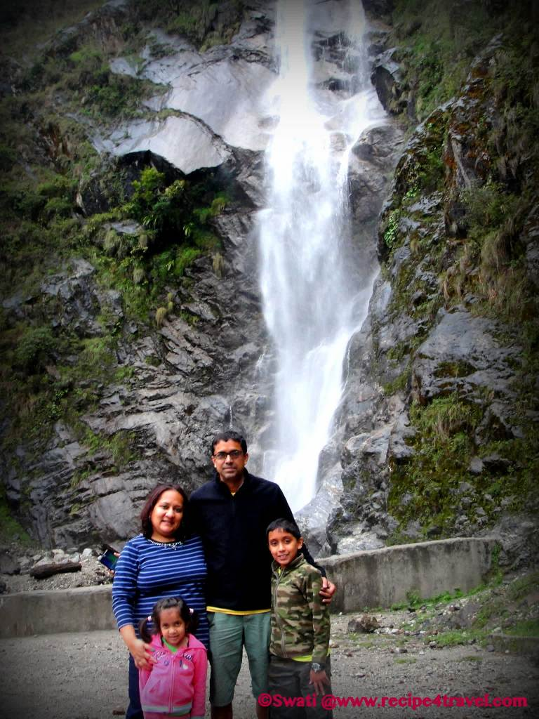 Family picture with the giant waterfall (Bhim Nala Falls aka Amitabh Bacchan Falls)