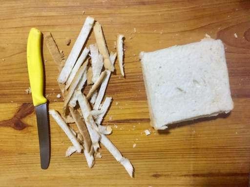 Trim sides of bread.