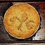 overhead shot of just baked chicken pot pie with a dill flecked crust