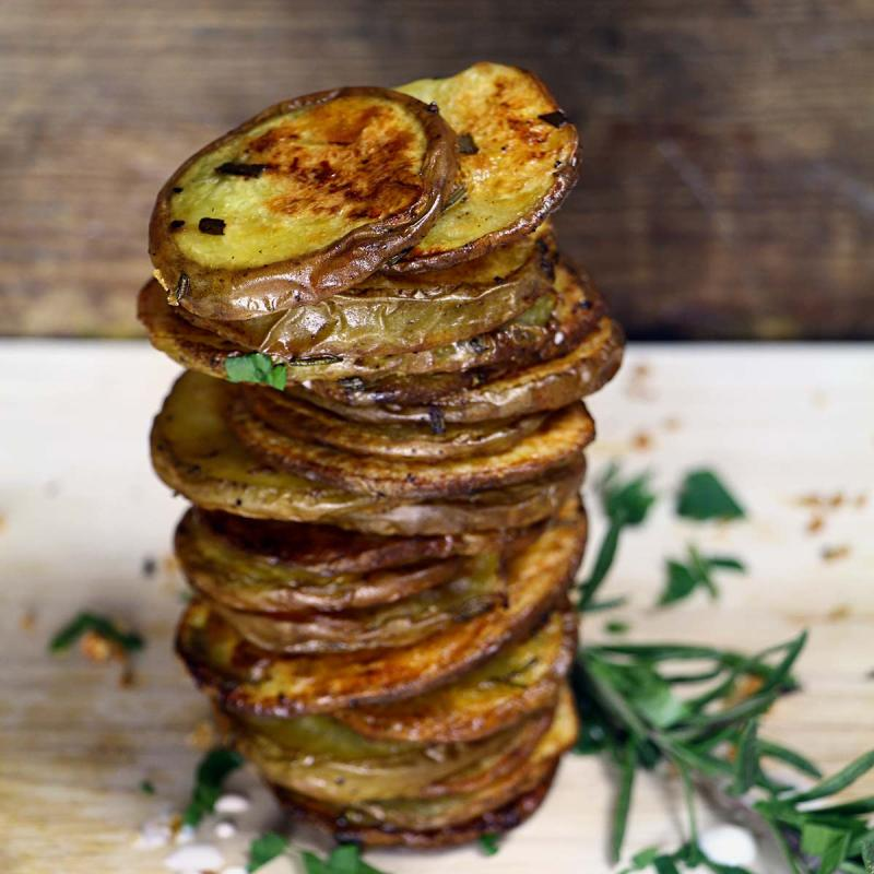 sliced and slow roasted rosemary potatoes