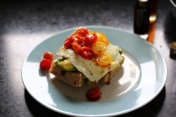 Avocado and Egg Elevated: Avocado toast with broiled tomatoes and date vinegar