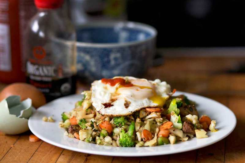 Cauliflower fried rice, topped with a crispy fried egg