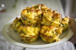 Savory French Toast Muffins piled on a white plate