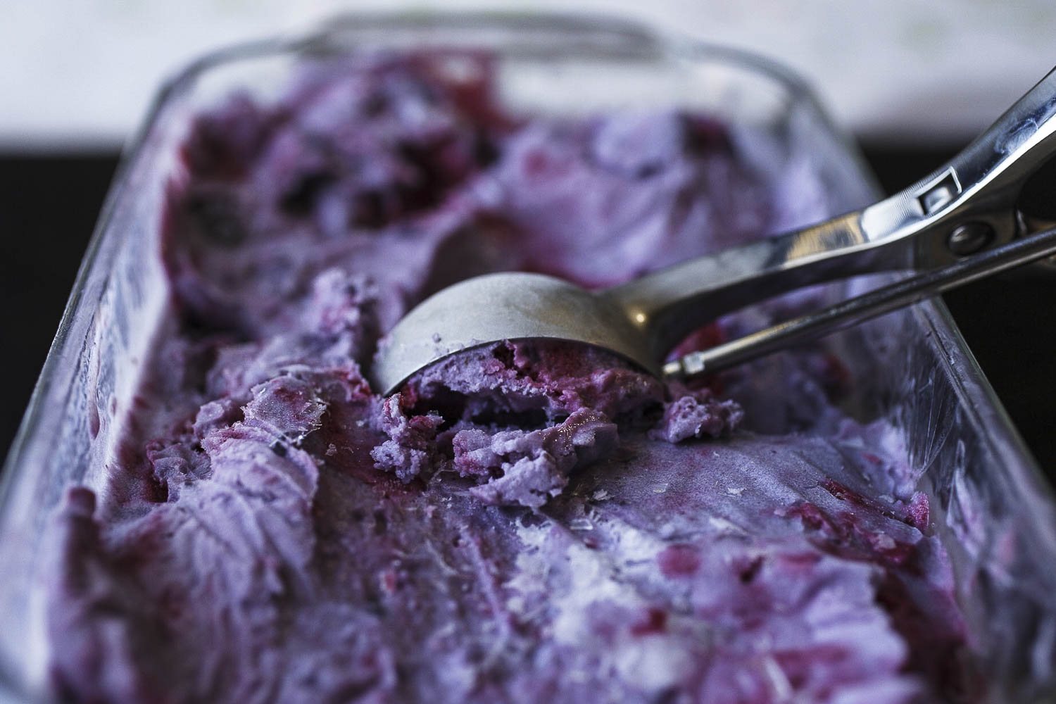 Roasted Blueberry Ice Cream with Raspberry Swirl close up
