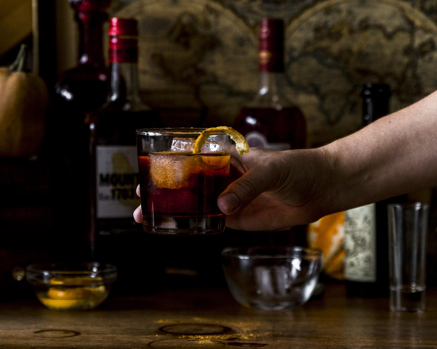 holiday rum negroni being held aloft
