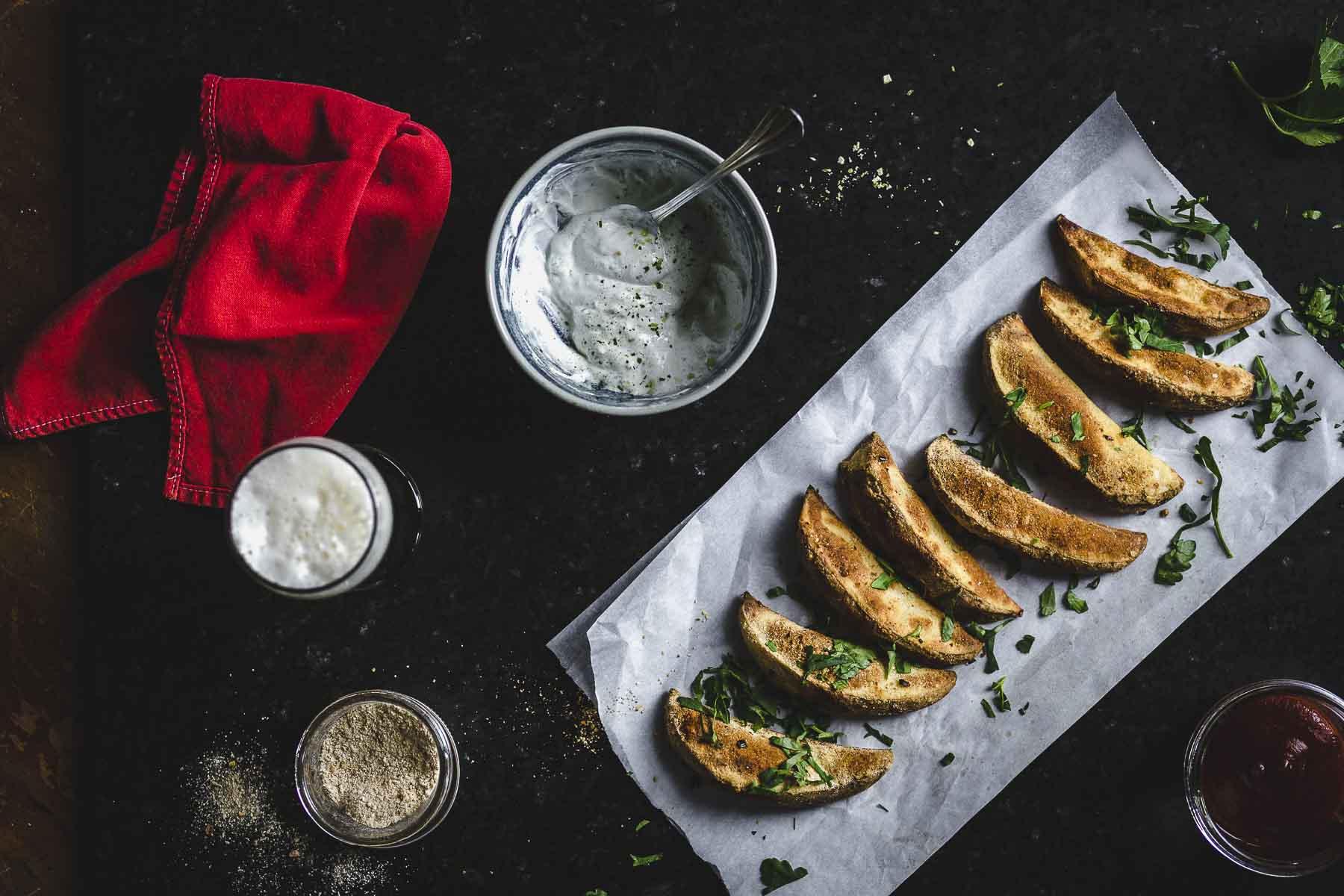 overhead of gluten free, shiitake mushroom, crispy oven baked Jo-Jos ewith dipping sauces