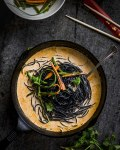 Coconut Curry Noodles with grilled pickled vegetables in cast iron pan