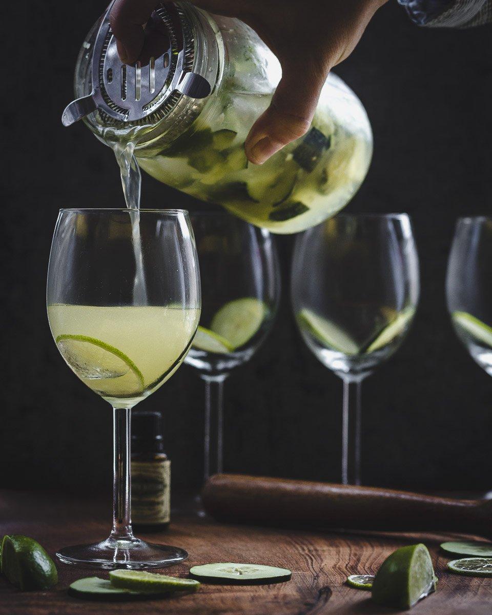 Pouring a Garden Gimlet: gin gimlet w/fresh cucumber, lime, & basil