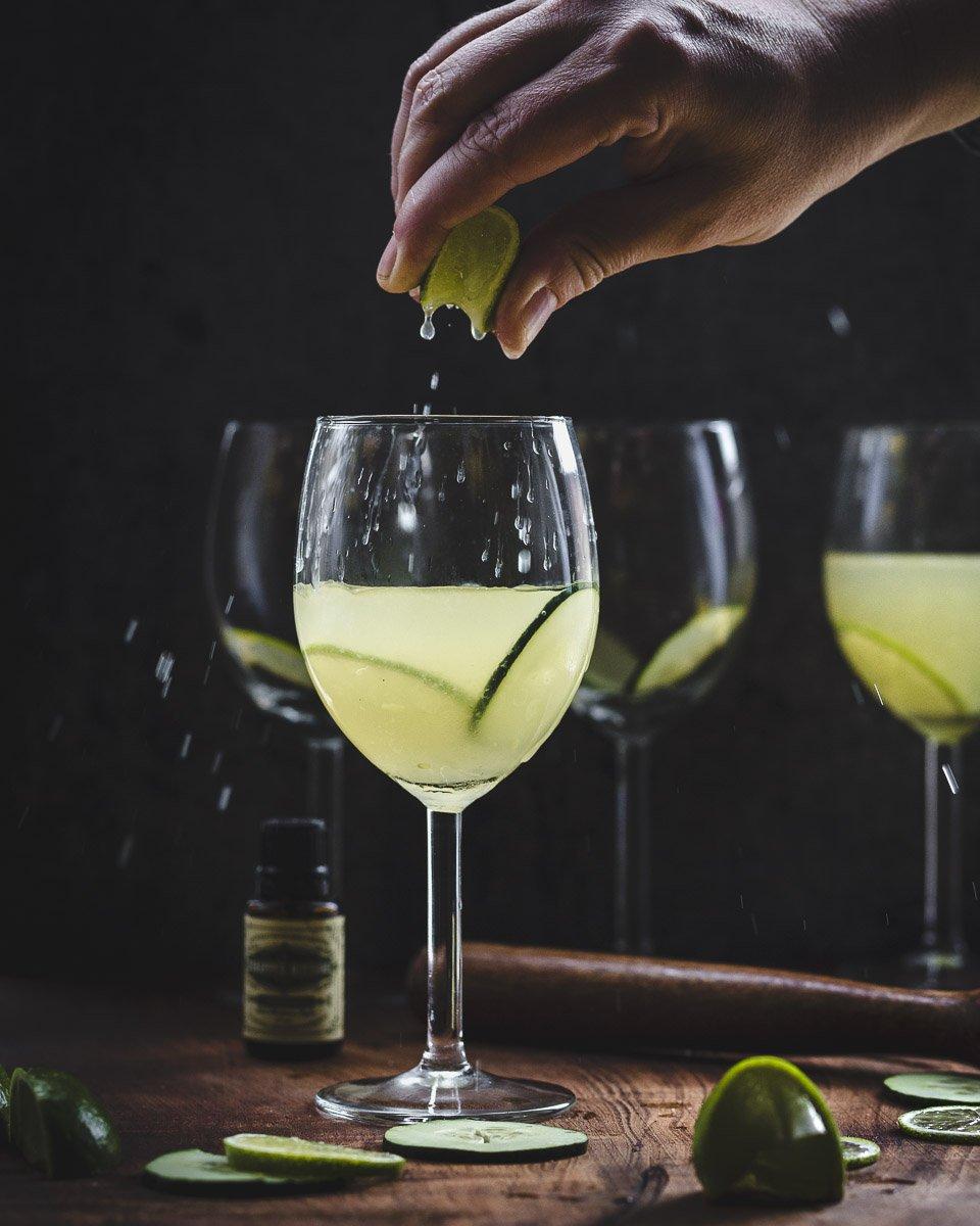 squeezing lime into a Garden Gimlet: gin gimlet w/fresh cucumber, lime, & basil