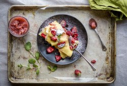 Sheet Pan Swedish Pancakes with fresh strawberries and lime