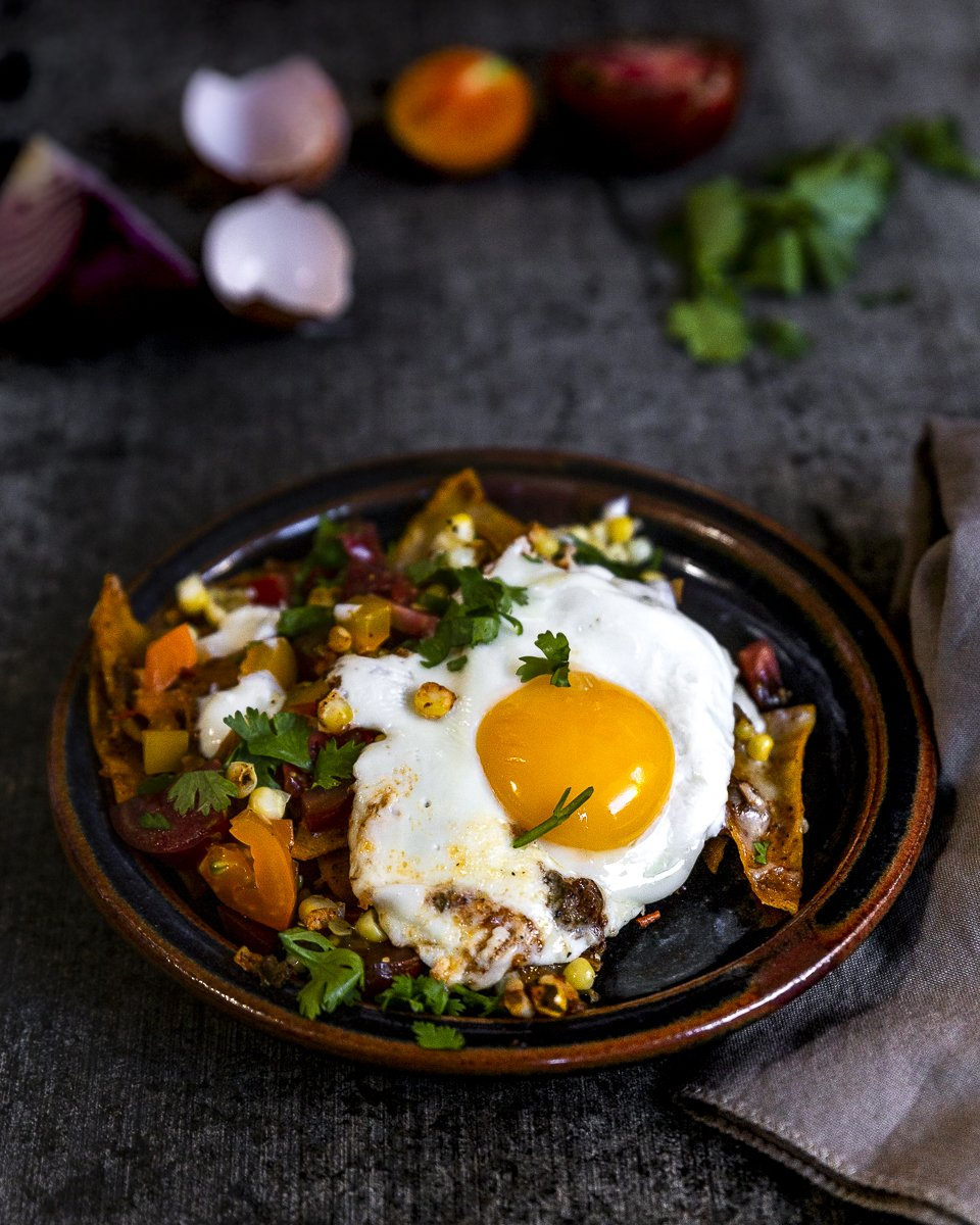 angle shot of Summertime Chilaquiles recipe with fresh tomatoes