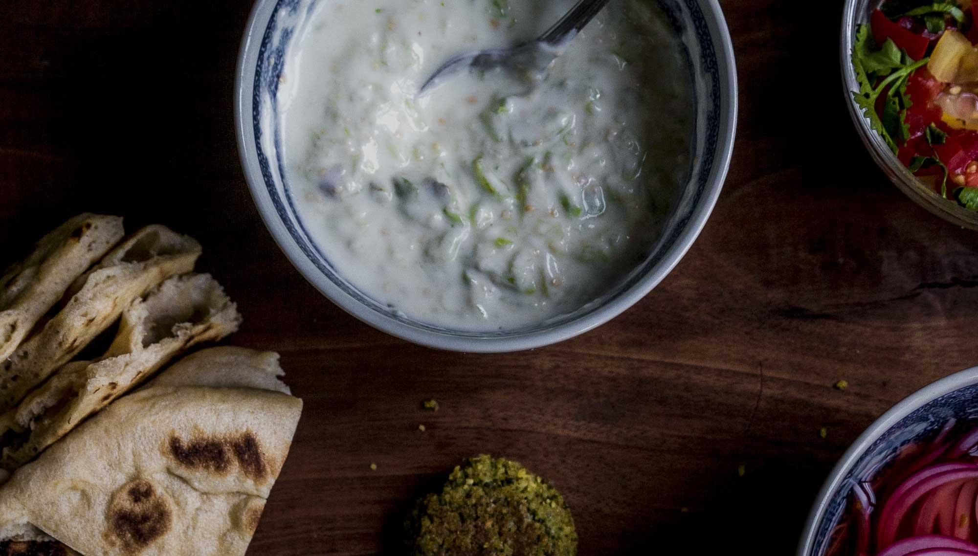 overhead shot of Tomatillo Tzatziki- raita, or just call it yogurt sauce