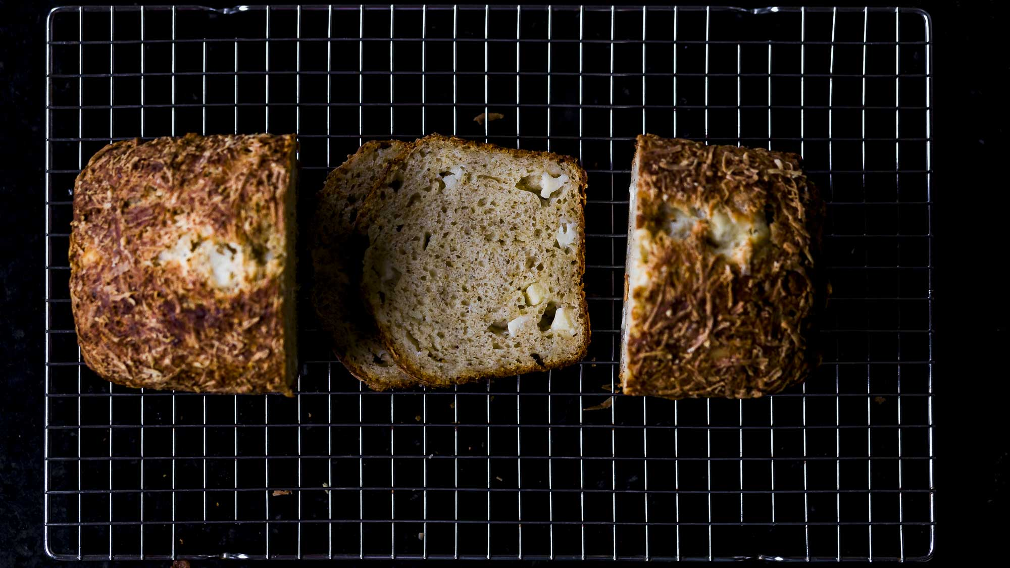 quick cheese bread with sharp cheddar and parmesan sliced and ready to eat