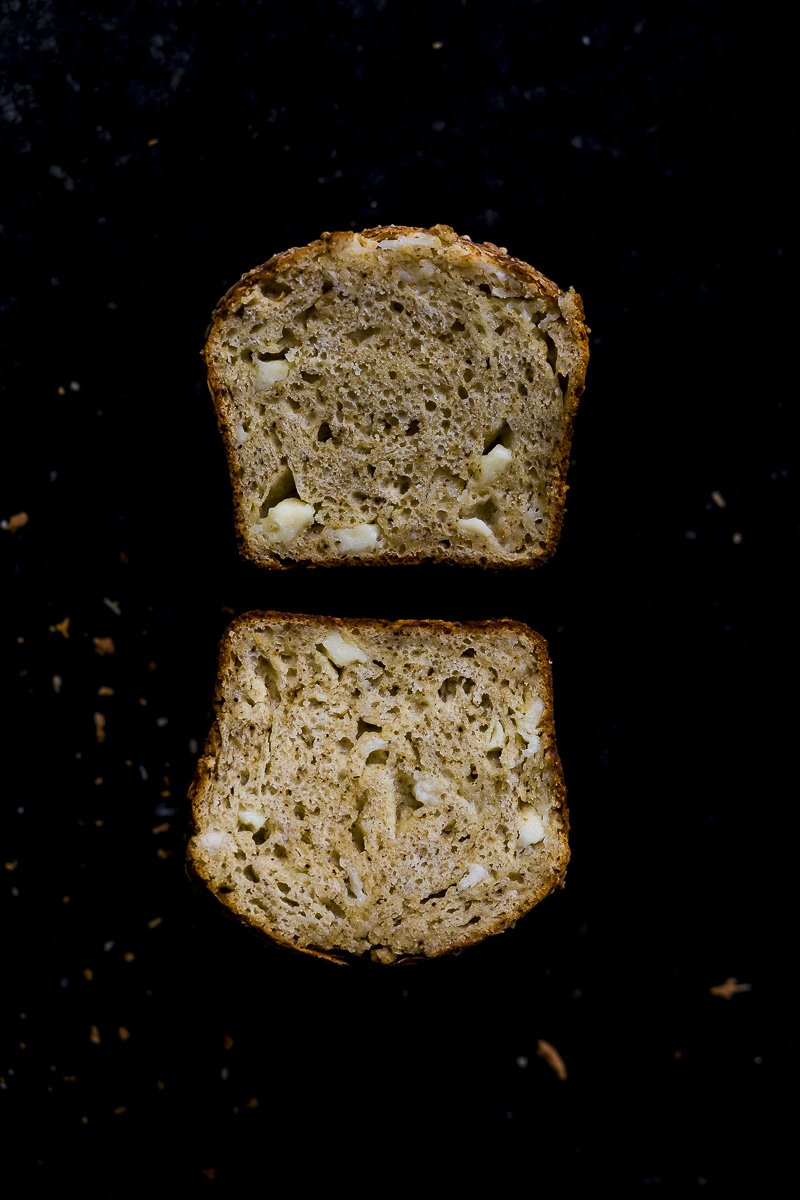 Quick Cheese Bread with parmesan and sharp cheddar sliced open to show the tender buttery crumb