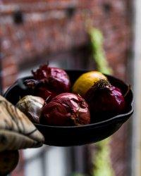 roasted veggies in a cast iron pan for Roasted Onion Cream- simple, vegan, onion sauce