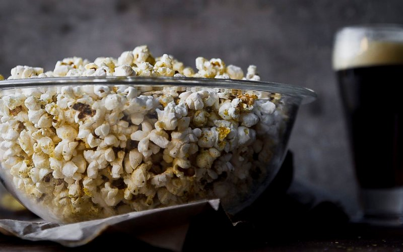a close up of a bowl of my favorite popcorn with nutritional yeast and ghee