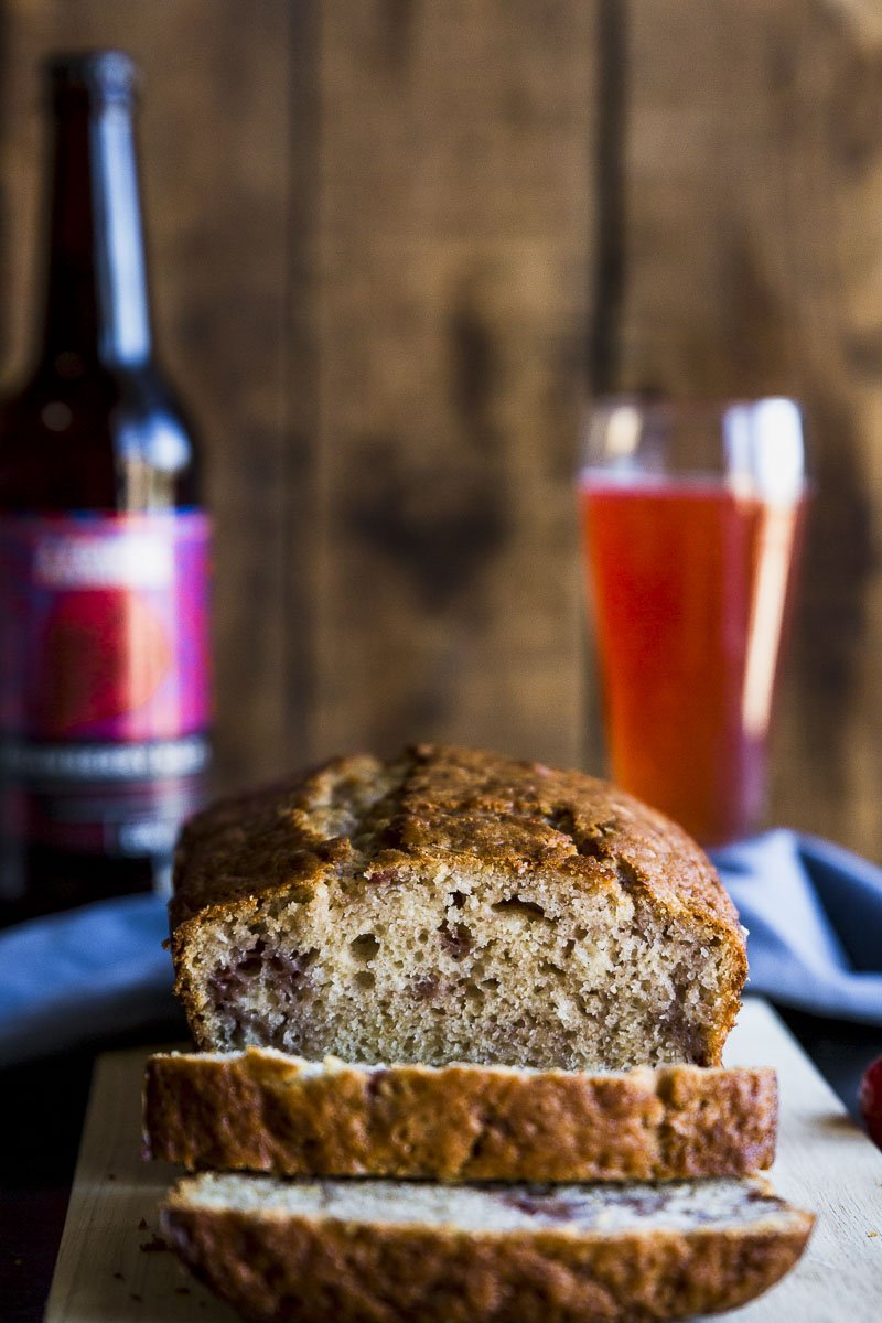 straight on shot of sliced strawberry cider quick bread