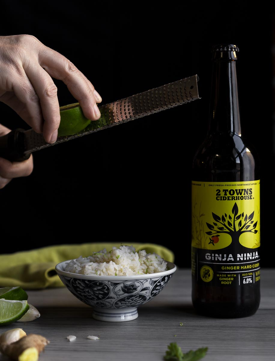 grating lime zest over ginger rice