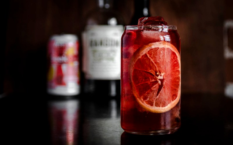 shows a closeup of the not negroni cocktail garnished with a thin slice of citrus in a pint sized glass