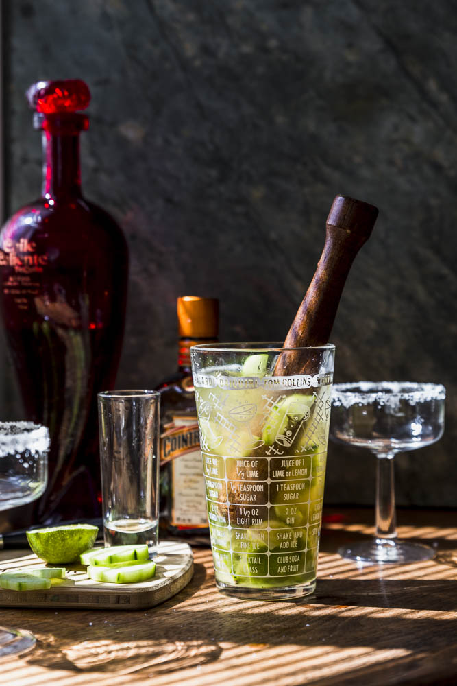 muddle the lime and cucumber with ice before shaking