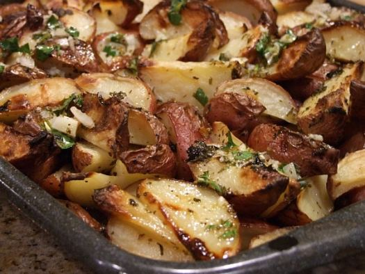greek potatoes with lemon vinaigrette on a baking sheet