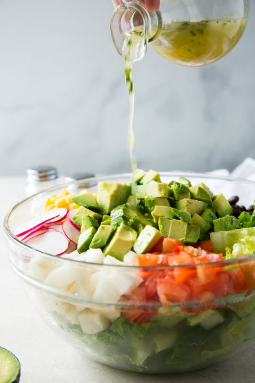 adding dressing to Mexican Chopped Salad