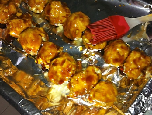 Brush the meatballs with the Sauce and Grill or Broil, Basting with the Sauce repeatedly