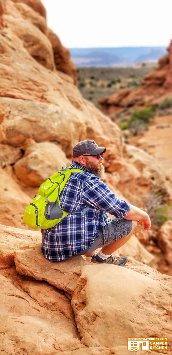 Man hiking Arches National Park