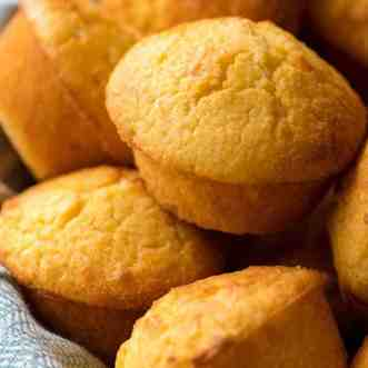 Close up of Cornbread Muffins in a basket, fresh out of the oven