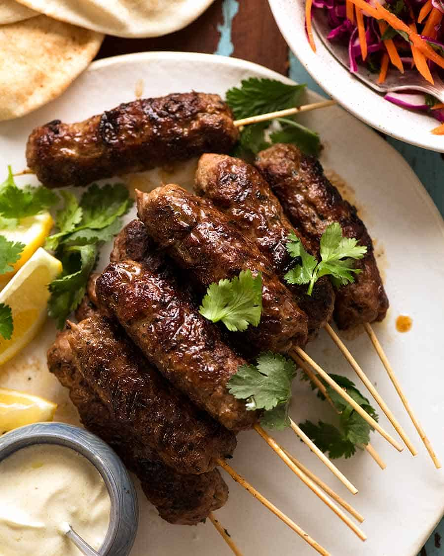Lamb Koftas on a platter, ready to stuff into pita bread with minted salad and yogurt sauce