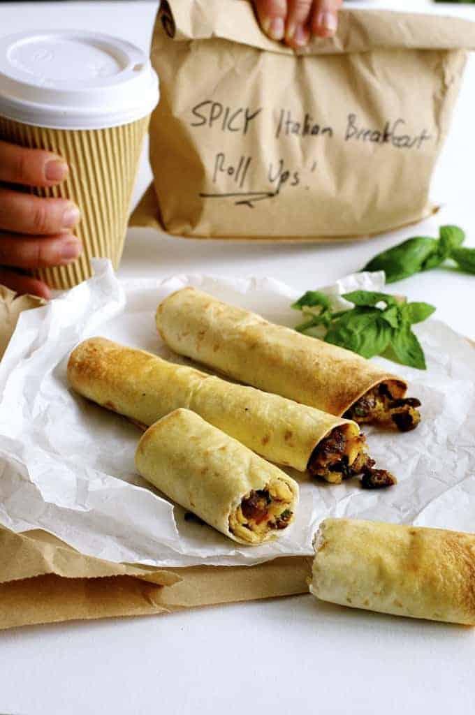 Spicy Italian Breakfast Roll Ups and paper takeaway bag