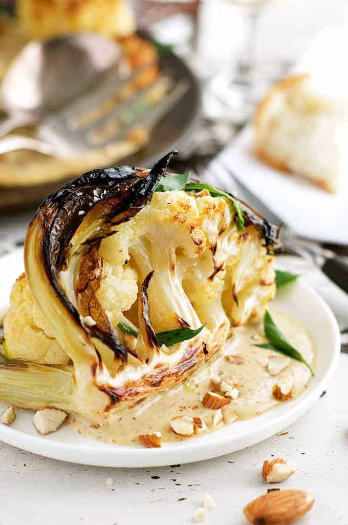 Ester's Roasted Cauliflower with Almond Sauce on a white plate