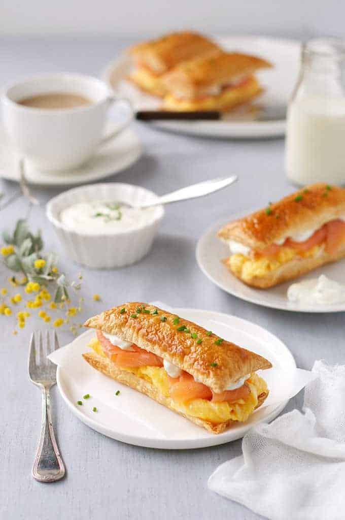 Breakfast table with Smoked Salmon and Egg Breakfast Mille-feuille and a cup of coffee
